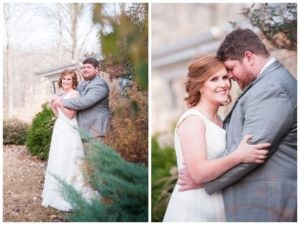 bride and groom standing near bushes with his arms around her and bride smiling at camera while groom nuzzles her