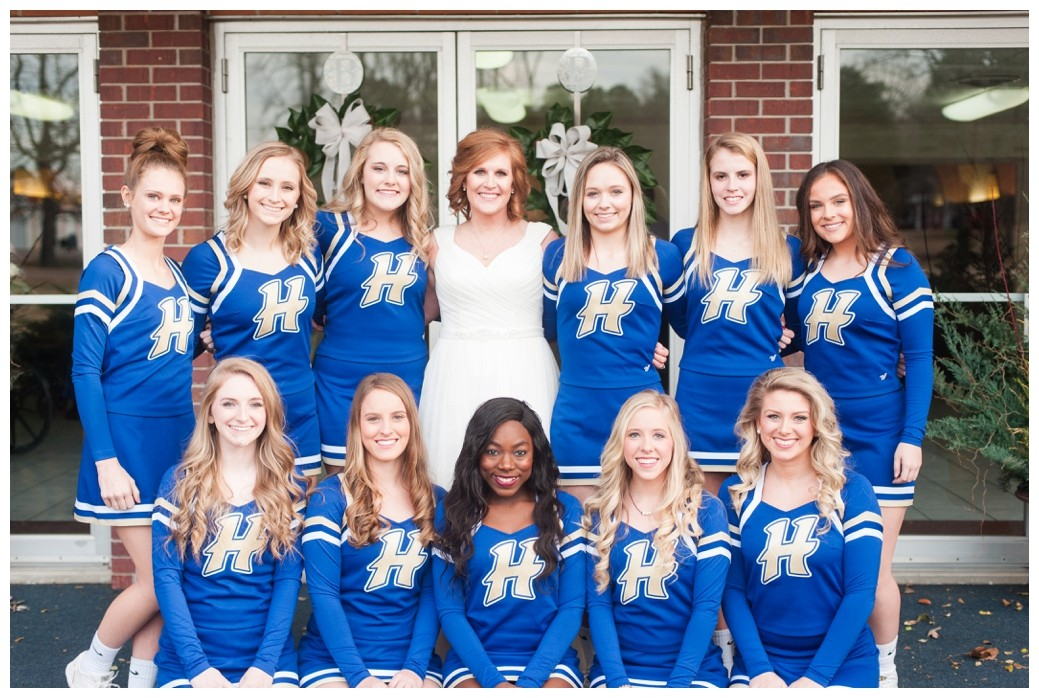 bride with the cheerleading squad she coaches