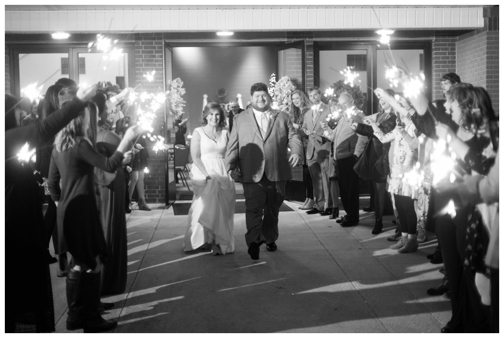 bride and groom sparkler exit black and white